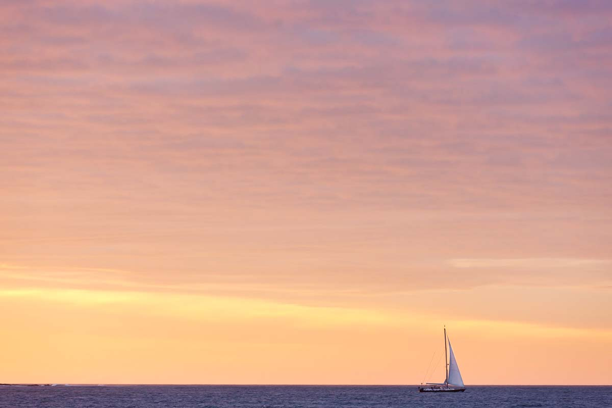 Lone Sailboat, Seawall